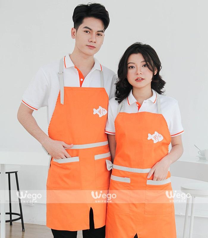 Mẫu tạp dề màu cam bắt mắt sẽ khiến đội ngũ nhân viên của bạn trông tươi trẻ